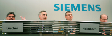 Scandal-hit Siemens sees Q2 profit cut by two-thirds