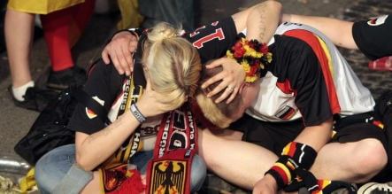 Spain rains on Germany's football party