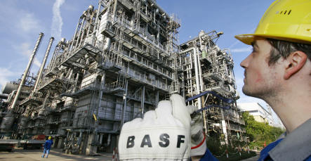BASF suspends work and cuts profit target
