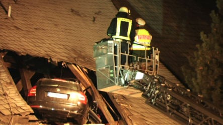 Speeding car launches into church roof