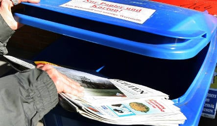 Man trapped in recycling bin while diving for keys