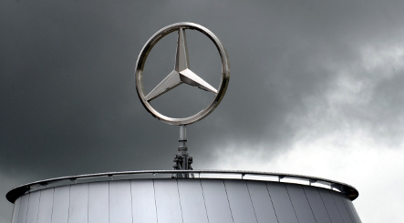 Daimler posts dire loss and cuts wages