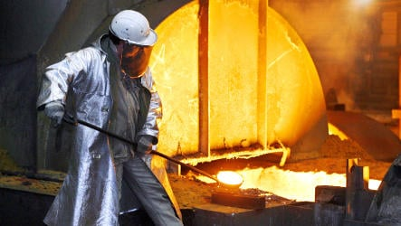 Steel production drops by half