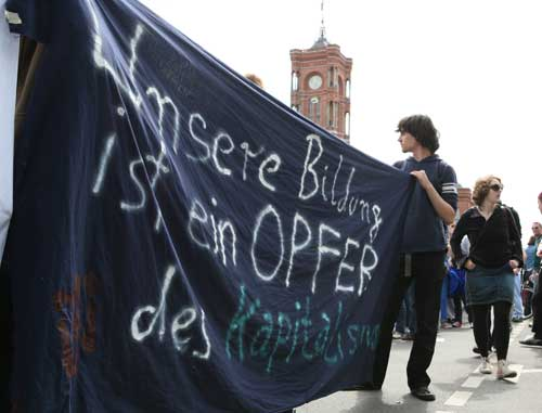 This banner reads: My education is a victim of capitalism.Photo: Sabine Devins photo