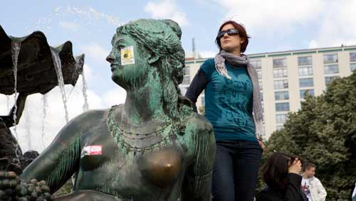 The square was filled with students. One of the women surrounding the Neptune Fountain wound up taking part.Photo: Sabine Devins photo