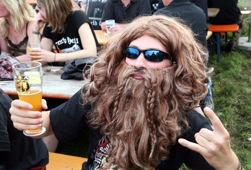 This fan is ready to rock with his viking beard. Photo: DPA