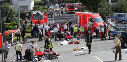 Two dead after retiree drives into parade