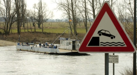 Man's ferry flub sends wife, kids and dog plunging into river