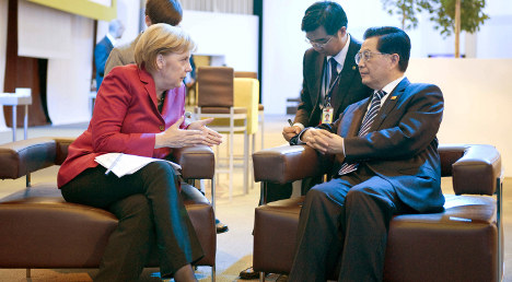 Merkel vows to prod China over human rights
