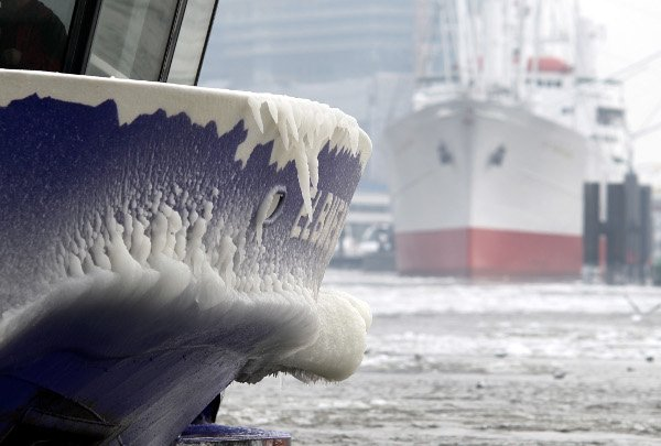 The prow of a harbour launch is frozen over with a thick layer of ice at St. Pauli Landungsbrücken in Hamburg Harbour on January 24, 2010.Photo: DPA