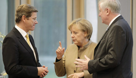 Conservatives and FDP agree to coalition 'crisis meeting'