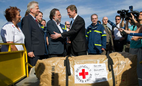 Westerwelle brings aid to devastated Chile