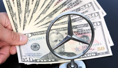 Daimler pays out to settle bribery claims
