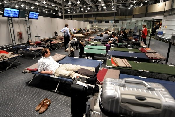 Stranded airline customers rest in Munich over the weekend. Photo: DPA
