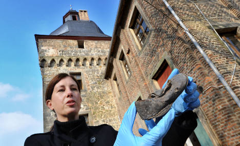 300-year-old shoes found in castle wall during restoration