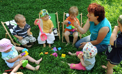 Day care guarantee not in danger, minister says