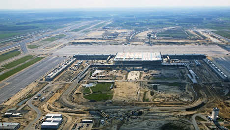 New capital airport up to nine months late