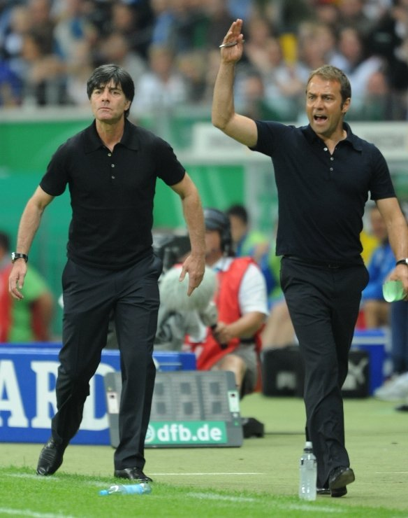 Joachim Löw and Hans-Dieter Flick<br>Coaches Joachim Löw and Hans-Dieter Flick on the sidelines. Löw has an extensive coaching history and has secured a place in the hearts of the German people by turning the German game from a static defensive style to a more exciting and fast-paced attacking style which has proven far more successful. The 50-year-old didn't have the most illustrious footballing career as a player, but his technical understanding and meticulous game planning and analysis have mPhoto: DPA
