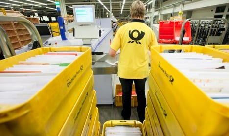 German post considers raising postage charges