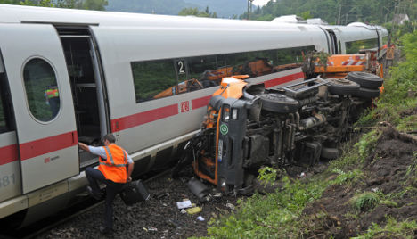 ICE train crashes into garbage truck, injuring 10