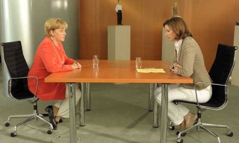 Merkel rejects industry attack on nuclear tax