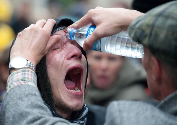 A protestor recovers from being pepper-sprayed. Photo: DPA