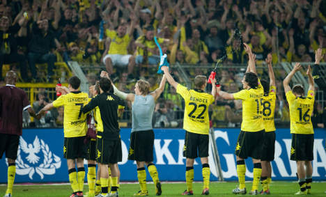 Dortmund takes second place as Schalke wins first game