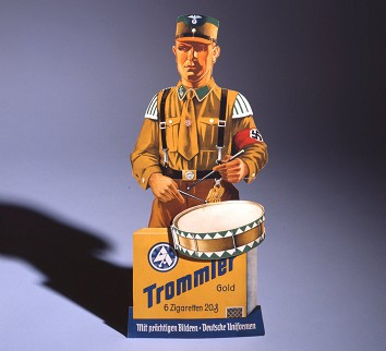 A piece of advertising which ran from 1933 to 1945. It shows a member of the <i>Sturmabteilung</i>, or <i>SA</i>, the paramilitary wing of the Nazi party. Photo: Indra Desnica/Deutsches Historisches Museum