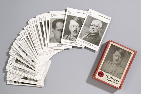 A deck of playing cards featuring Adolf Hitler and other prominent Nazi officials. One purpose of the exhibition is to show how the Nazi ideology influenced the everyday. Photo: Sebastian Ahlers Privatsammlung Rainer Graefe/Deutsches Historisches Museum