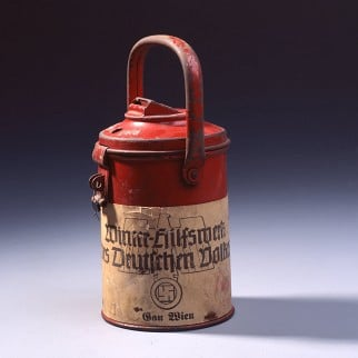 A collection tin for the <i>Winterhilfswerk</i>, an annual drive by the <i>Nationalsozialistische Volkswohlfahrt</i> (the National Socialist People's Welfare Organization) to collect money for food and coal for poorer families during the winter months. Photo: Arne Psille/Deutsches Historisches Museum