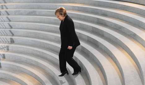 Merkel urges EU leaders to stand up for euro