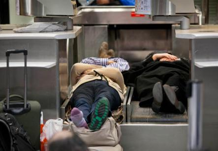 Passengers in Frankfurt Airport find unusual beds for the night due to flight cancellations. Photo: DPA
