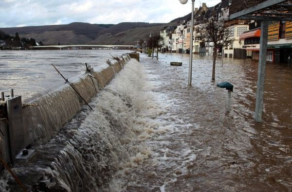 Waters of the Mosel river breaching the banks at Zell, Rhineland-Palatinate, on Friday. Photo: DPA