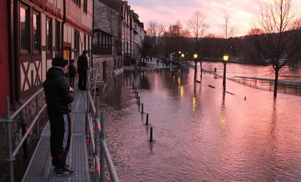 Residents survey the flooding at Hannoversch Münden in Lower Saxony where the Weser River starts.Photo: DPA
