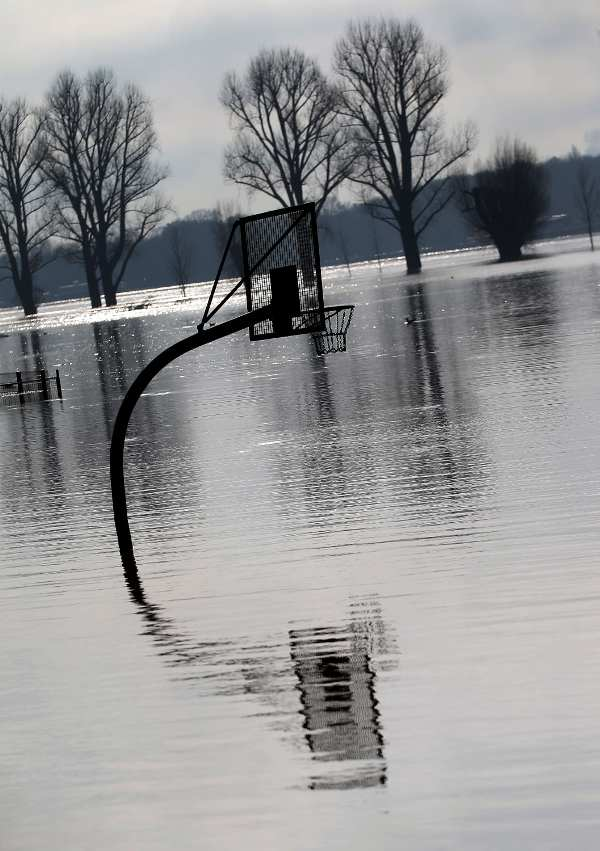 Floodwaters cover a basketball court in Cologne, where flood prevention agency officials expected Tuesday that water levels would continue to fall.Photo: DPA