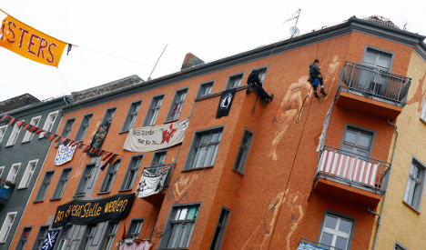 Residents of former squat square up for forced eviction