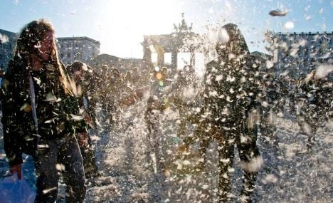 Feathers fly at mass pillow fight in Berlin