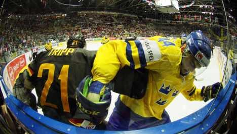 German ice hockey hopes melt in face of red-hot Swedes