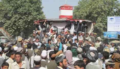 Protest leaves soldiers hurt, Afghans dead