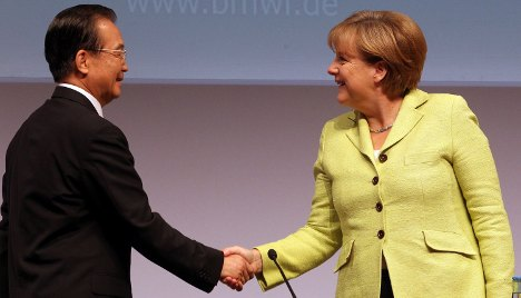 Berlin inks deals, differs with Beijing on rights