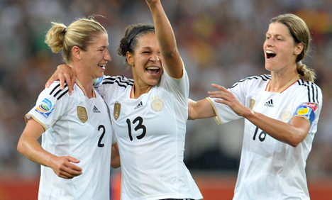 Germany tops group with win over France