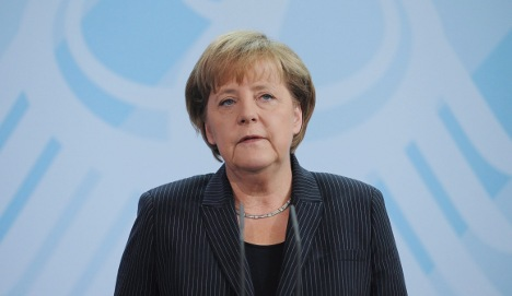 Merkel talks euro rescue with France and Spain