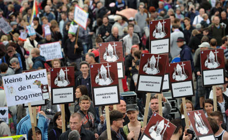 Protesters rally as pope speaks to parliament