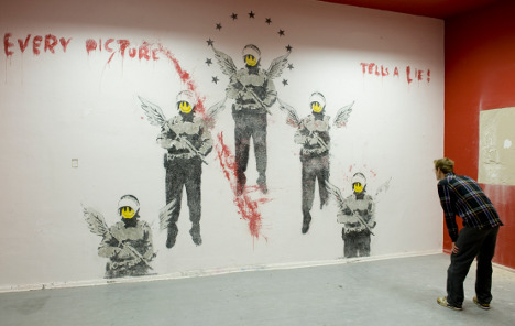 Eight-year-old Banksy work uncovered in Berlin