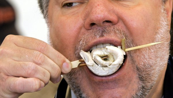 Rollmops<br>Hungover? Do as the Germans do and have a pickled herring rolled up around an olive, held together by a wooden stick. Rollmops have been a staple snack in Germany for hundreds of years and are still hailed today as a cure for excess, as well as a healthy treat.Photo: DPA