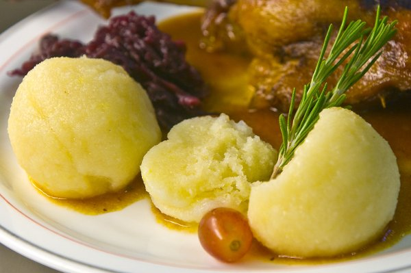 Knödel<br>Don't be put off by its bland appearance; the German dumplings called Knödel or Klöße are a culinary must during the winter months. A doughy ball formed from flour, potato or breadcrumbs, this stodgy stroke of genius is a great addition to stews, on the side of a dish, or even as a meal itself. And for those who prefer sweet from savoury, the Knödel can also be made with sugar and fruit. Photo: DPA