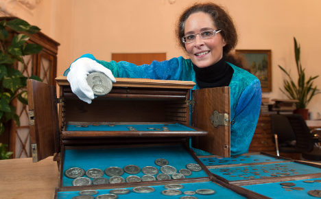 Nosey janitor discovers ancient coin hoard