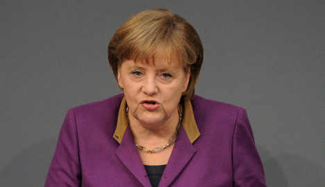 Merkel bows under pressure to up bailout