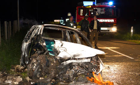 Locals pull three from burning car wreck