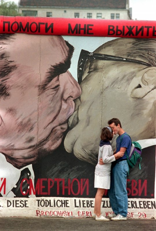 The Socialist Brotherhood Kiss<br>Of course, back in the old days, kisses between world leaders were a lot hotter and heavier. Communist leaders always went for a proper smackeroo - as a symbol of joy, fraternity, and equality between fellow socialist nations. Erich Honecker and Leonid Brezhnev shared the most famous of these, which was immortalized on the Berlin Wall by Russian artist Dmitri Vrubel.Photo: DPA